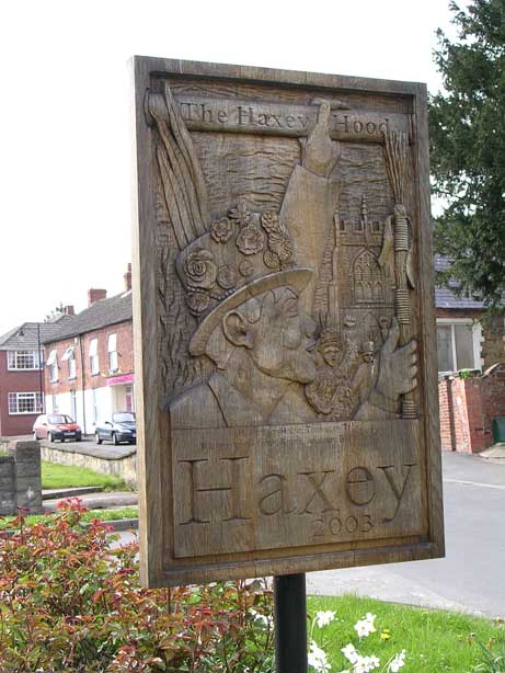 Carved wooden Haxey Hood sign