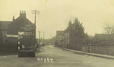 Later postcard of Low Street and the Market Cross